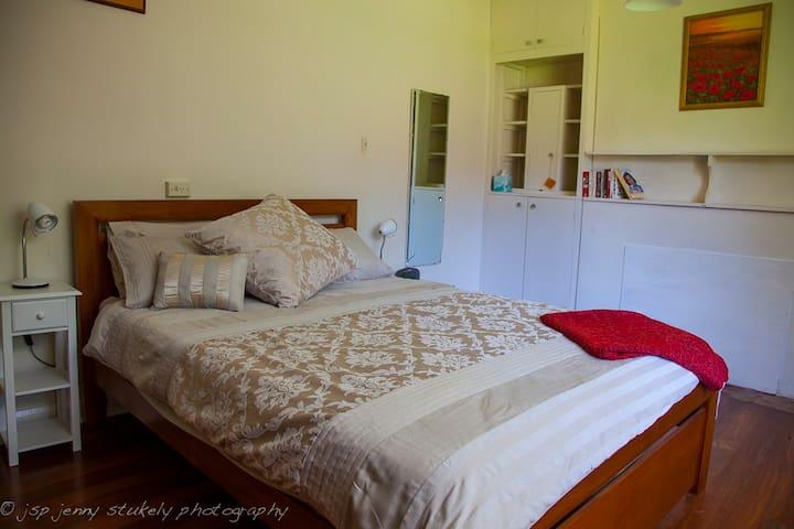 Bedroom 1 - queen bed and loads of space.