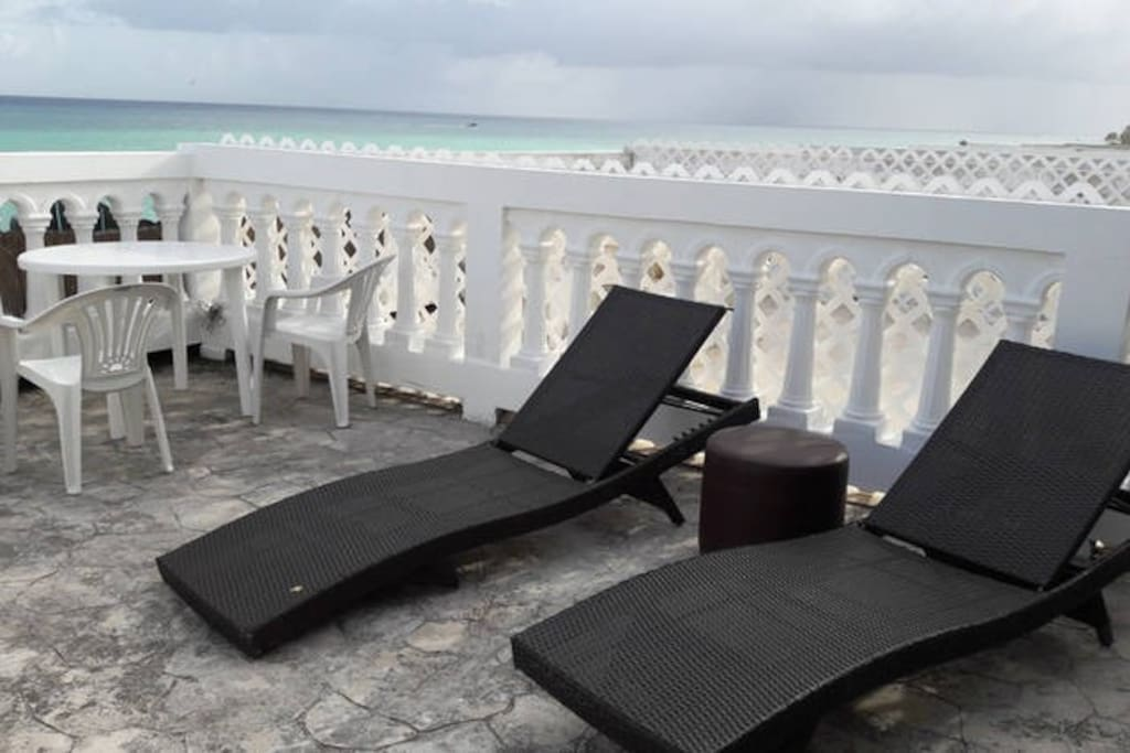 Relax in the big beach front terrace and feel the breeze