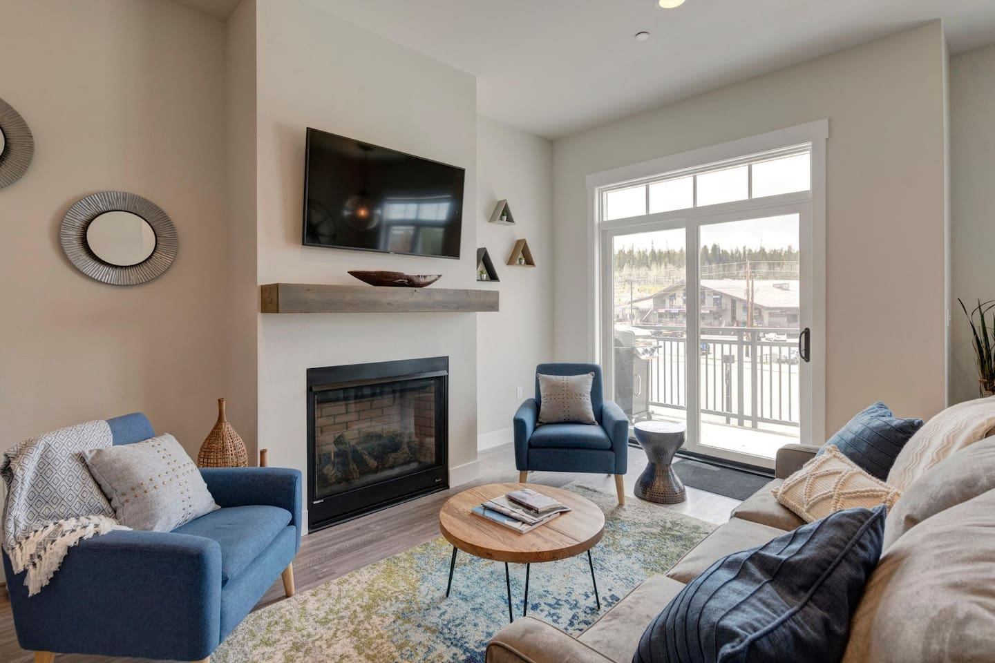"""Main seating with 50"""" 4K TV and queen size sleeper sofa"""