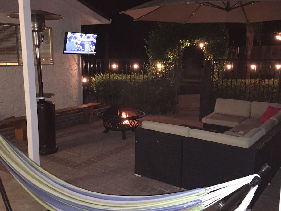 """The hammock and outdoor furniture make great spots to watch a game on the 40"""" TV"""