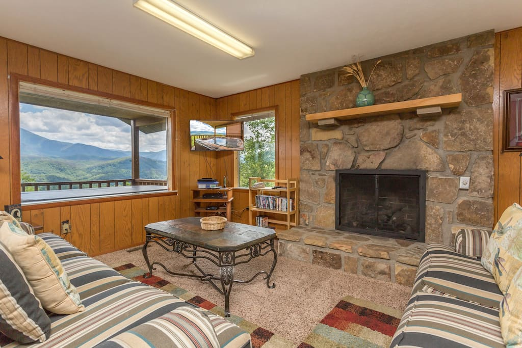 Living Room With Stone Fireplace, Flatscreen TV, And Amazing Views!