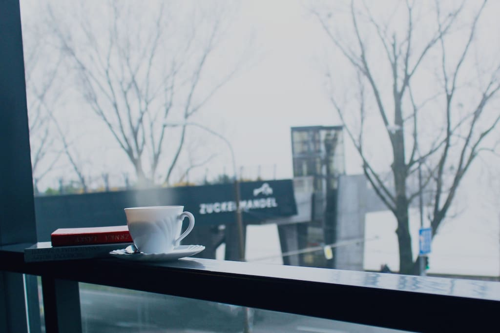 Enjoy your morning coffee on the balcony overlooking the river and a modern walkway