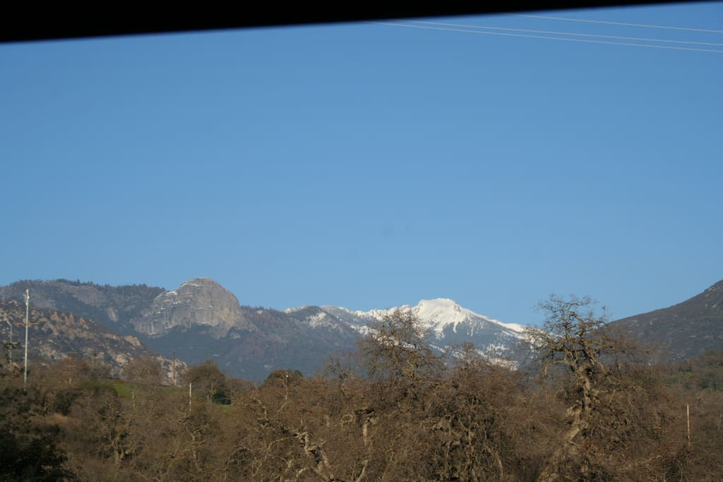 The winter view from the cabin porch with snow on the mountains.