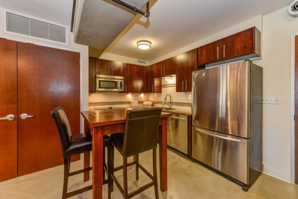 New cabinetry, granite counter tops, and stainless steel appliances
