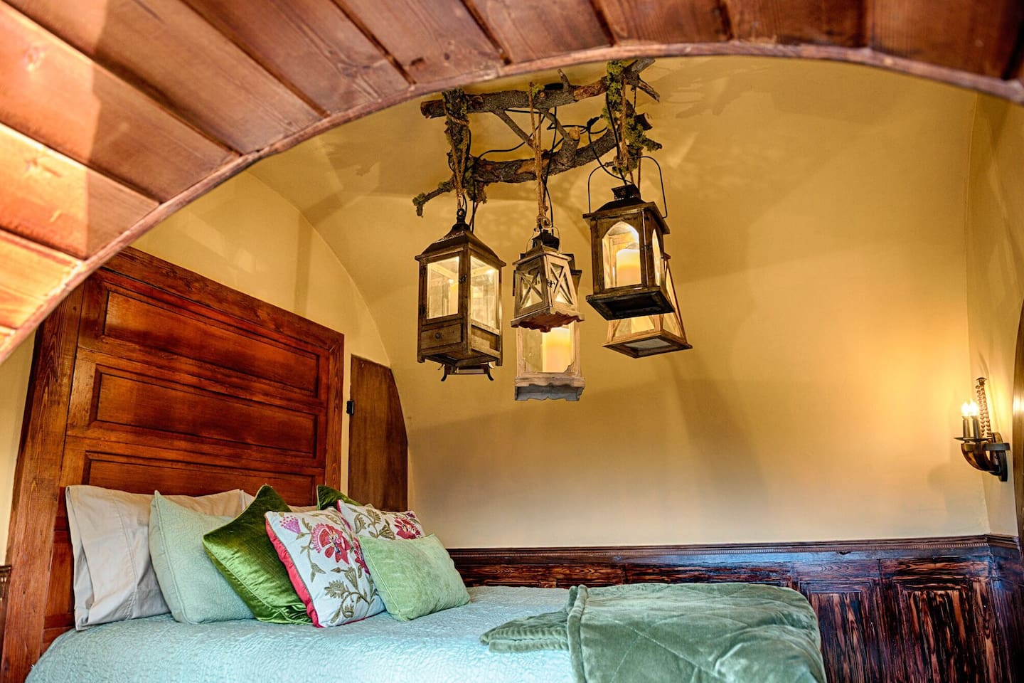 This charmingly romantic getaway features a bed and chandelier lovingly crafted by the home owner.