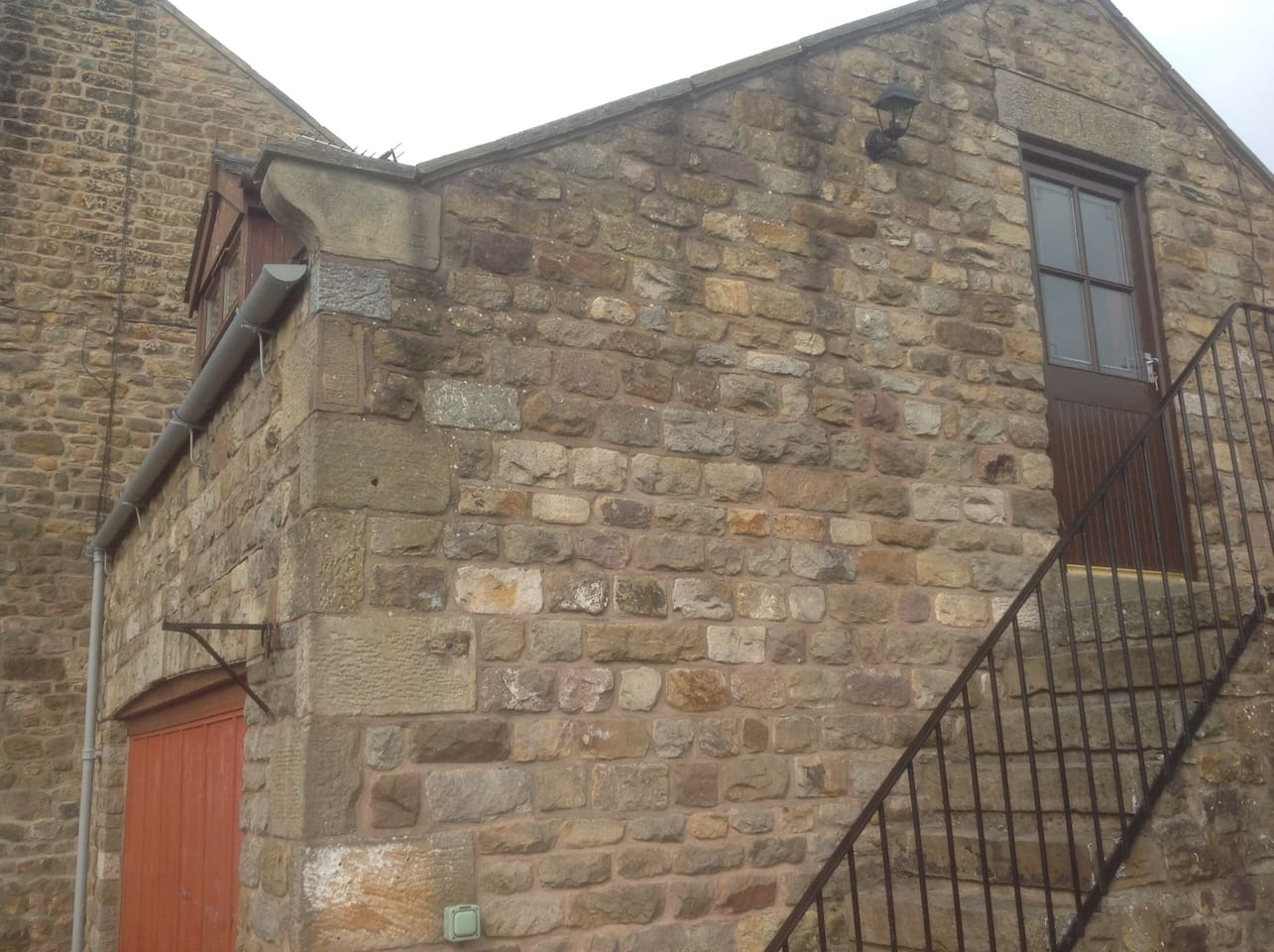 Access to the studio is up the stone steps at the side of the property.