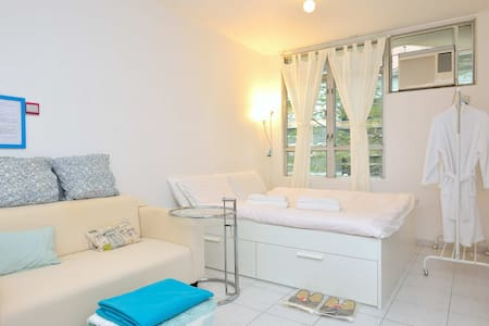 500 sq. feet (~50 sq. meter) whole apartment: very spacious for HK standard!  1 minute to MTR station & big shopping mall; 21 minute to Causeway Bay  Queen size big bed for 2 and Single bed for 1; free of charge for additional guests.