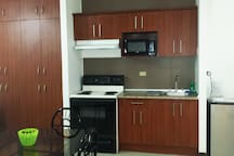 Full kitchen with everything you need for your short or long term stay!