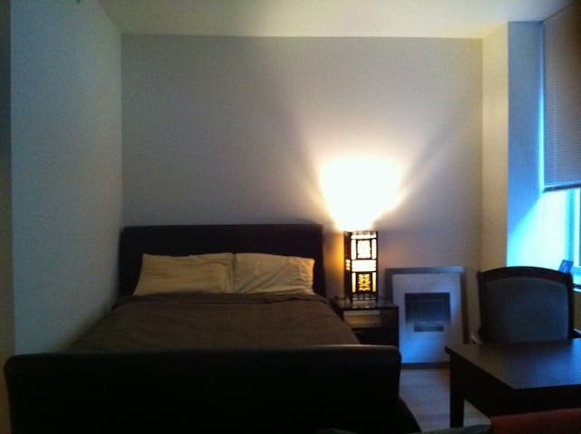 Sleep Alcove with queen bed, desk and chair