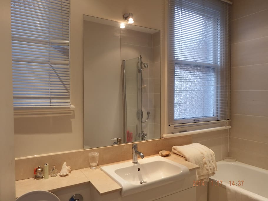 Private bathroom with shower next to your luxury double room