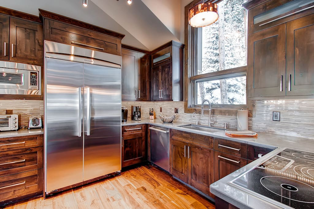 Enjoy high end appliances in the modern and spacious kitchen