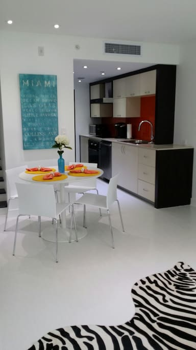 Modern kitchen includes everything needed for your stay including a Kuerig coffee maker, dishwasher, full refrigerator, microwave oven, Bosch oven, stove top, and washer/dryer