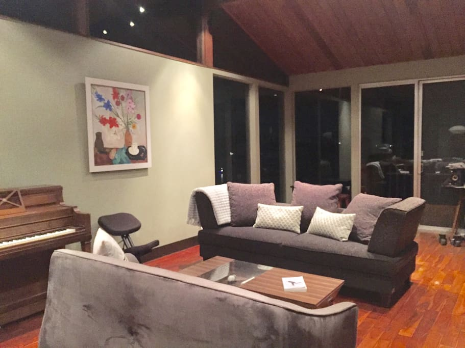 Cozy living room area with views and piano !!