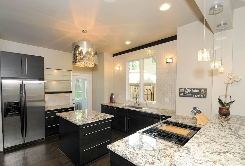 Amazing, luxury gourmet kitchen with professional range, stainless steel appliances, double oven, exotic marble countertops, and more!