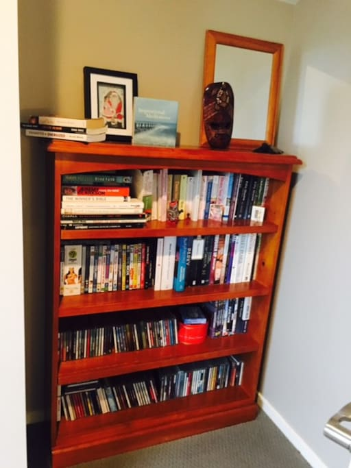 Bookshelf in room to help yourself to.