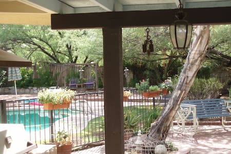 Welcome to beautiful Tucson! Take a siesta at our lovely home. Large park-like backyard with mesquite trees and swimming pool. Easy access around town. Hike in nearby Sabino Canyon. We have 3 pups & 2 cats, so animal friendly people best-suited.