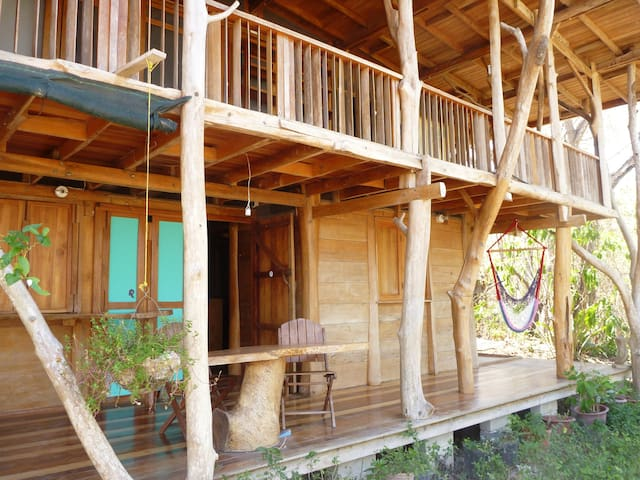 Teak house w/ private beach in jungle setting