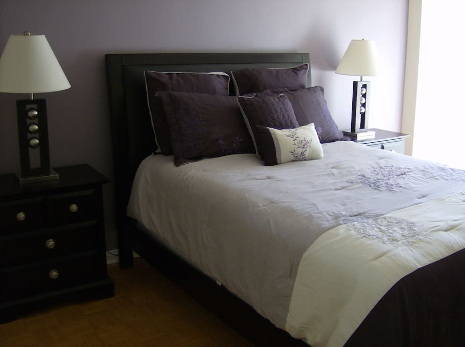 Second bedroom with queen size bed and quality bedding