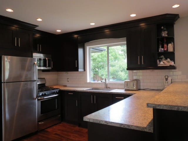 Modern, upgraded kitchen with stainless appliances
