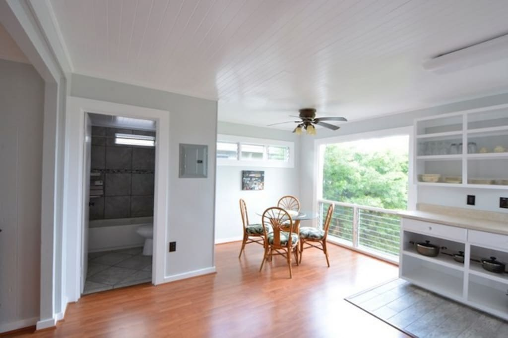 Door to bath; dining area/kitchen
