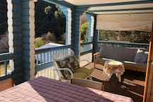 The verandah....couch converts to a futon double-bed. Great for sleeping in the summer.