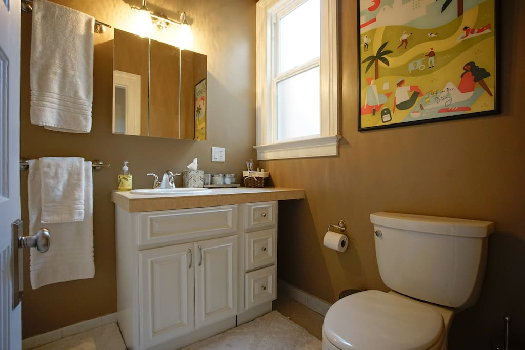 Your private modern bathroom across the hallway from your room with shower over tub and the comforts of a home