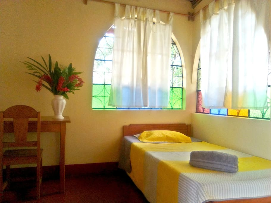 Doble bed suite with  big windows to our magical and ethnobotanical garden.