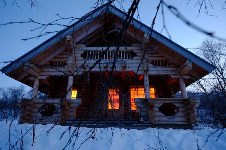 A magical log cabin with Northern Lights view
