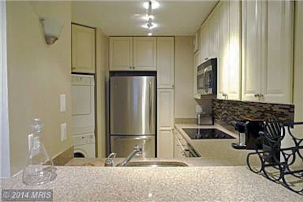 Kitchen with stainless steel appliances & quartz counter tops