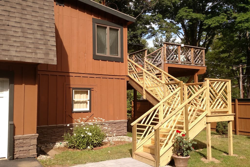 Custom stair case leading to the two tier deck overlooking gardens and walkway to the kayaks and lake.