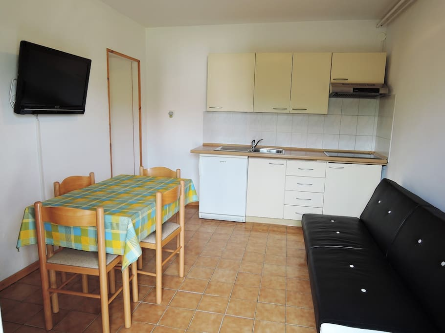 Kitchen, dining room and sofa