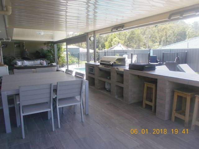 Outdoor BBQ, Oven, Gas Wok Cooktop,  Sink with Hot & Cold Water Dining Area - with seating up to 10 people High Chair available  Outdoor Lounge All Outdoor Areas have pull down blinds in case of rain 2 Industrial fans for those really hot days