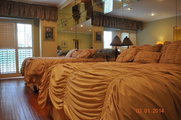 two queen beds grace the spacious master bedroom.