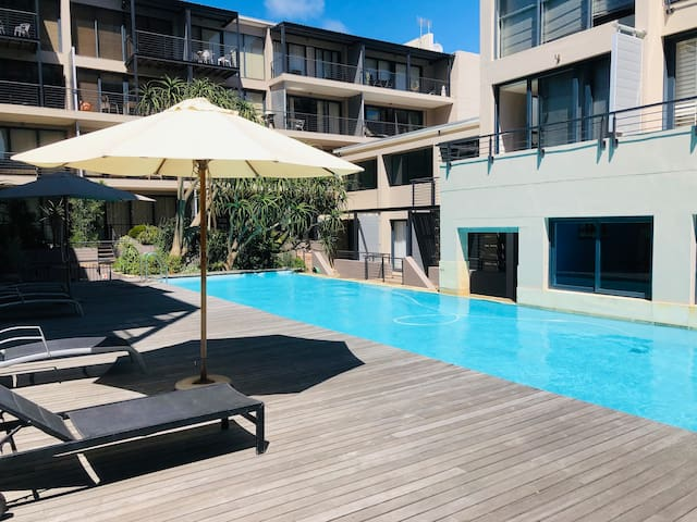 Shared pool with sun loungers