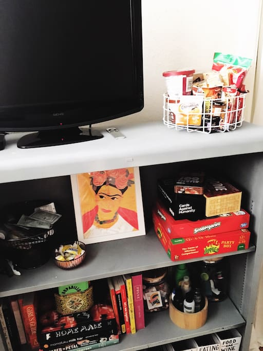The TV has a DVD player attached and we also provide Apple Tv in the room that is linked to our cable. There are also various magazine, fun books, and games for your use. We have also provided a few snack options.