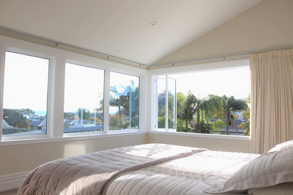 Master bedroom, soaked in natural sunlight