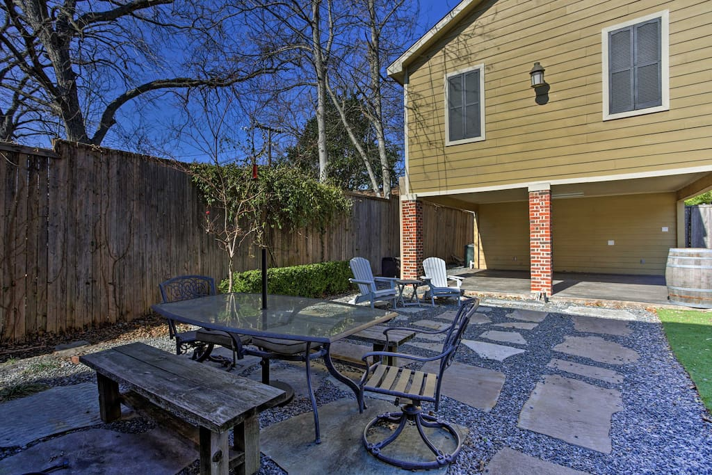 Enjoy a meal alfresco in the spacious backyard as the kids play in the yard.