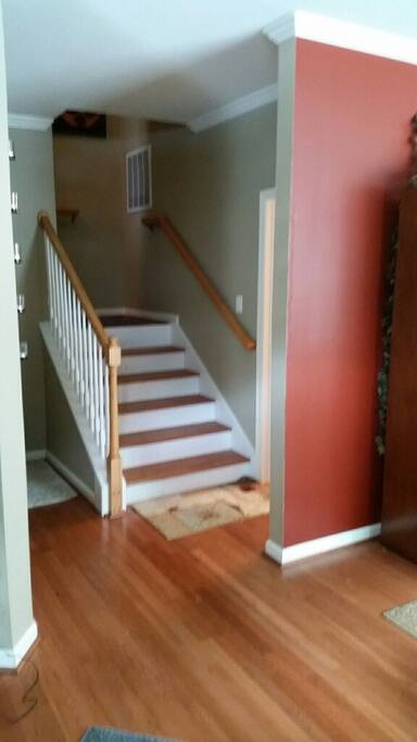 Front door entry to stair to room