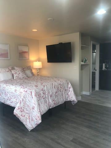 Downtown Studio apartment queen bed half kitchen.