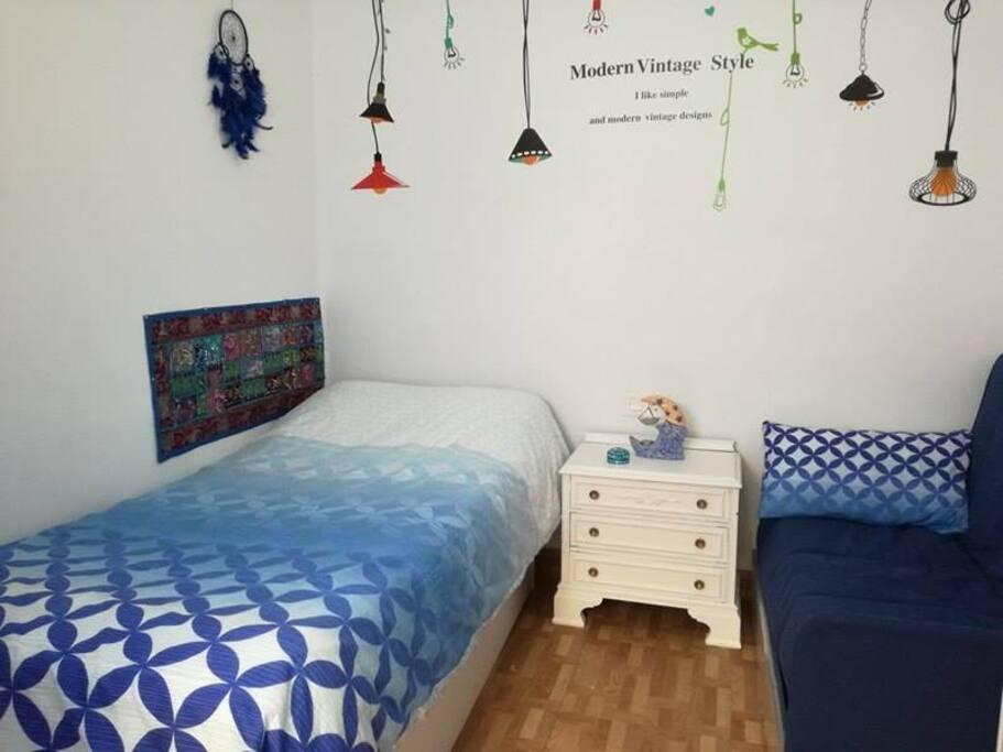 Habitación individual con sofá