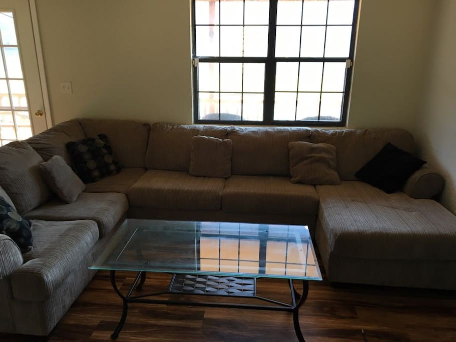 Living Room with sectional sofa.  Two people could sleep here.