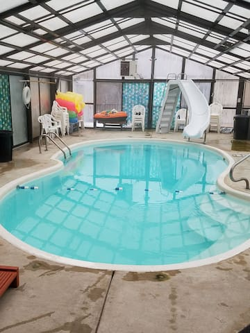 Enclosed swimming pool with hot tub.