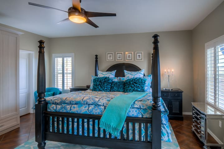 Master Bedroom Retreat has California King Bed, Upgraded Linens, TV, and a Ceiling Fan
