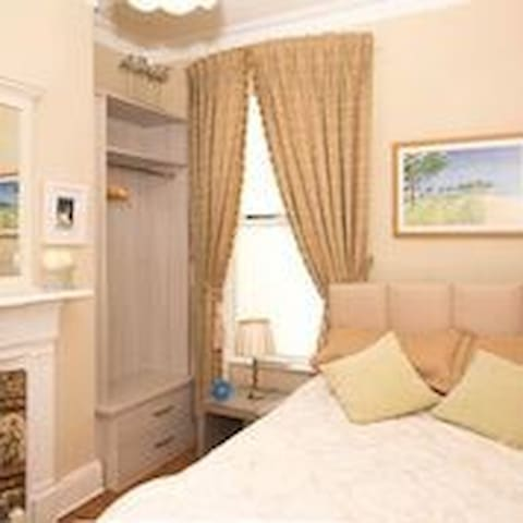 Double bedroom in elegant Victorian townhouse.