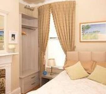 Double bedroom in elegant Victorian townhouse.