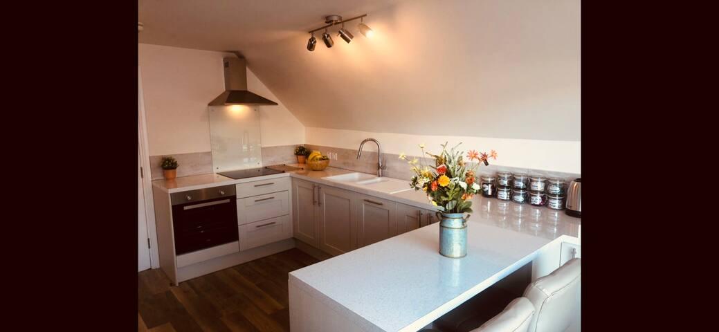 Beautiful modern fitted kitchen with dishwasher, fridge, freezer, microwave