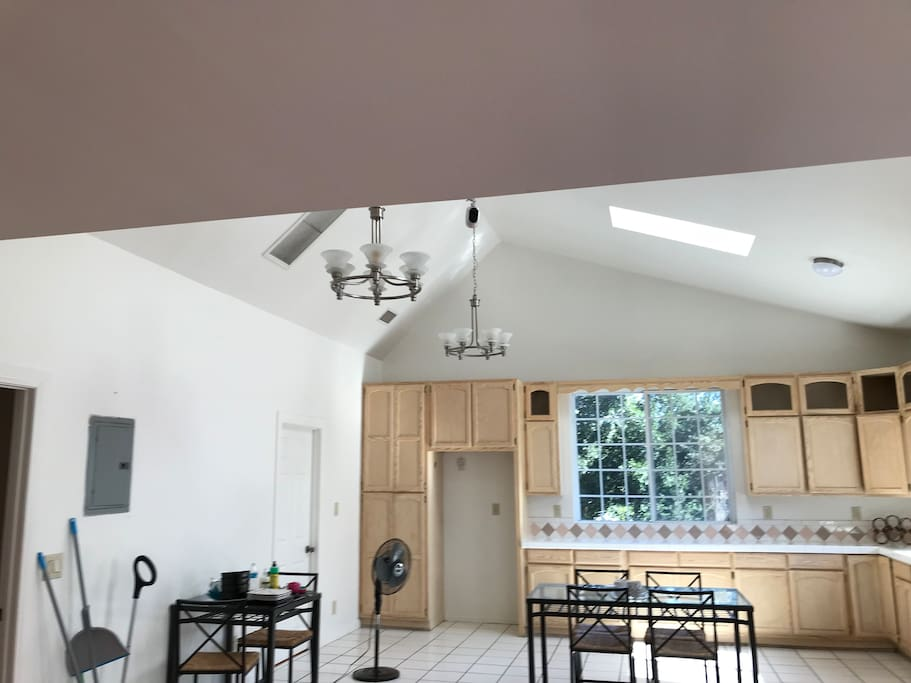 "High ceilings, skylights, and plenty of natural lighting enhance the openness of this ""great"" room."