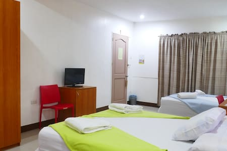 Premium Room (1 Queen sized bed and 2 single beds)