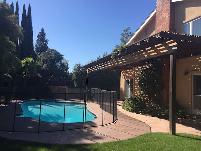 The pool is fully enclosed with child safety fencing.