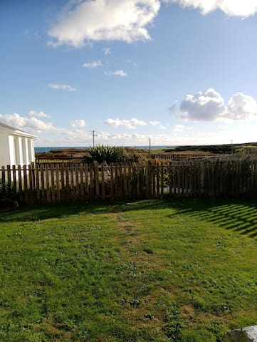 Back patio and garden with lovely sea views.